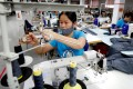 Workers at a garment export factory in Hanoi. Vietnam has become a hub for foreign direct investment within the past decade. Photo: Reuters