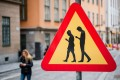 A road sign warning against pedestrians focusing on their smartphones is seen near the old town in Stockholm. Sweden is the latest European country to ban use of telecoms gear from Huawei Technologies and ZTE Corp for upcoming 5G mobile networks. Photo: Agence France-Presse