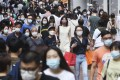 Shoppers crowd the streets in Causeway Bay on Sunday as the social-distancing rules against coronavirus relax. Photo: Edmond So