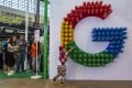 People wait in line in front of Google's booth at the Big Data expo in Guiyang, China in May 2018. Photo: EPA-EFE