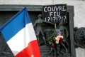 A placard placed on the Republique statue in Paris on October 18 questions the French government's controversial imposition of an overnight curfew after a rise in Covid-19 infections. Photo: Reuters