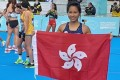 Christy Yiu celebrates after shattering her Hong Kong record at the 2020 IAAF World Half Marathon Championships in Poland. Photo: HKAAA
