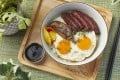 Wagyu char siu and foie gras rice served with fried eggs at Glasshouse Greenery. Photo: handout