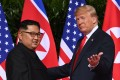 """US President Donald Trump with North Korean leader Kim Jong-un in Singapore in June 2018. Trump said he and Kim had exchanged """"beautiful"""" letters during his presidency. Photo: AFP"""