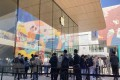 Apple fans waiting to enter the Apple Store in Sanlitun, Beijing, after the company's first 5G smartphone hit shelves on Friday. Photo: Minghe Hu