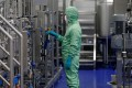 A technician works at a manufacturing facility of Chinese vaccine maker CanSino Biologics in Tianjin, China. The company is working with a fetal cell line called HEK293 to find a vaccine for Covid-19. Photo: AFP
