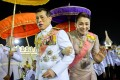 Thailand's King Maha Vajiralongkorn and Queen Suthida greet royalists as they leave a religious ceremony in Bangkok on Friday. Photo: Reuters