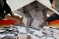 Officials are to press ahead with a plan to allow voting across the border. Photo: Reuters