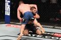 Khabib Nurmagomedov takes down Justin Gaethje in their lightweight title bout at UFC 254 on Fight Island in Abu Dhabi. Photo: Josh Hedges/Zuffa LLC via Getty Images