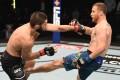 Justin Gaethje kicks Khabib Nurmagomedov in their lightweight title bout at UFC 254 on Fight Island in Abu Dhahi. Photos: Josh Hedges/Zuffa LLC via Getty Images