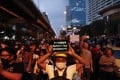 Pro-democracy demonstrators march to the German Embassy in central Bangkok on Monday as lawmakers debated in a special session in parliament. Photo: AP