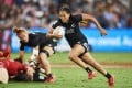 New Zealand's record-breaking rugby sevens player Tyla Nathan-Wong secures another try at a 2019/20 season World Sevens Series game. Photo: Getty Images