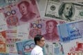China has phased out the countercyclical factor used to determine the midpoint of the yuan's daily trading range against the US dollar. Photo: AP