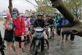 Hoi An residents commute in the aftermath of Typhoon Molave. Photo: EPA
