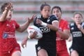 New Zealand's Tyla Nathan-Wong escaping Canadian clutches during the 2017 World Rugby Women's Sevens Series final in Kitakyushu, Fukuoka prefecture, Japan. Photo: AFP