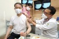 South Korean Health Minister Park Neung-hoo receiving his flu shot as part of efforts to demonstrate the safety of vaccinations administered under the state-led programme. Photo: YNA/DPA