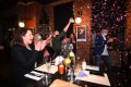 Patrons and staff celebrate the end of Melbourne's coronavirus lockdown at a steakhouse on Wednesday. Photo: EPA