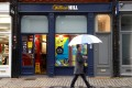 A man walks past a branch of bookmaker William Hill in London. Photo: Reuters