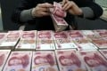 The yuan has gradually strengthened against the US dollar since the end of May, while foreign holdings of high-yield yuan-denominated bonds continue to increase. Photo: AP