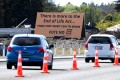Cars pass a billboard urging voters to vote No against euthanasia in Christchurch, New Zealand. Photo: AP