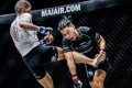Strawweight champ Xiong Jingnan catches Tiffany Teo at Inside the Matrix. Photos: ONE Championship