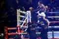 Gervonta Davis knocked out Leo Santa Cruz in Texas to claim the WBA super featherweight and lightweight titles. Photo: AP
