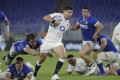 England's Ben Youngs breaks free of the Italian defence as England claim the delayed Six Nations title. Photo: AP