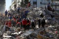 Members of rescue services search in the debris of a collapsed building for survivors in Izmir, Turkey, after a powerful earthquake that struck Turkey's Aegean coast and north of the Greek island of Samos on Friday. Photo: AP