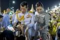 Thailand's King Maha Vajiralongkorn and Queen Suthida greet royalists at the Grand Palace in Bangkok on Sunday. Photo: AP