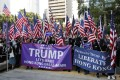 Hong Kong protesters carrying American flags and banners appeal to US President Donald Trump at a December 2019 rally. Photo: AP