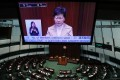 A large screen shows Chief Executive Carrie Lam at a question and answer session in the Legislative Council in January. Photo: Sam Tsang