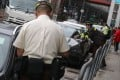 Traffic wardens issue tickets to illegally parked cars in Sheung Wan in April. Photo: K.Y. Cheng