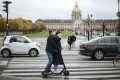 A masked couple ride an electric scooter past the Invalides memorial in Paris on October 25. A curfew intended to curb the growing spread of the coronavirus has been imposed in many regions of France including Paris and its suburbs. Photo: AP