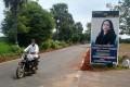 A man drives past a banner of US Democratic vice-presidential nominee Kamala Harris at the village of Thulasendrapuram, Tamil Nadu, India. Photo: Reuters