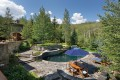 Nestled among the aspens, 183 East Fork Lane in Snowmass Village, Colorado, has an outdoor pool and multiple patios. Photo: Knight Frank & Douglas Elliman