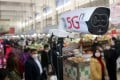 A new thermal temperature detector using 5G scans customers at a market in Suzhou, in China's Jiangsu province, on February 20. When these devices detect anyone with a high temperature, they send out warning signals and identify the person using facial recognition technology. Photo: Imaginechina