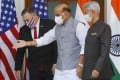 Indian Defence Minister Rajnath Singh (centre) gestures towards US Secretary of State Mike Pompeo. Photo: AP