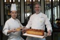 Kenny Chan, head chef, and Cary Docherty, executive sous chef at the Lobster Bar and Grill in the Island Shangri-La hotel in Admiralty, Hong Kong, with their pâté en croute, one of several seasonal game dishes on the menu. Photo: Xiaomei Chen
