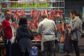 Patrons buy meat from a butcher's stall in Hong Kong, where the per capita meat consumption rate is among the highest in the world. Photo: EPA