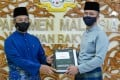 Prime Minister Muhyiddin Yassin (left) and Finance Minister Zafrul Aziz, posing with the national 2021 budget. Photo: AFP