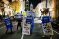 Activists dressed as United States Postal Service mailboxes, the White House and Philadelphia City Hall gather on a street in Philadelphia, Pennsylvania, on November 5. Photo: Reuters