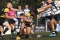 Borrelli Walsh USRC Tigers' Charlie Wilson gets tackled by men's Premiership title-holders Natixis Hong Kong Football Club on Saturday. Photo: SCMP/Xiaomei Chen