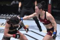 China's Yan Xiaonan throws a punch at Brazil's Claudia Gadelha during their UFC Fight Night strawweight bout UFC APEX in Las Vegas. Photo: Jeff Bottari/Zuffa LLC)