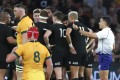Referee Nic Berry shows a red card to Australia's Lachie Swinton. Photo: AP