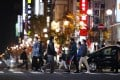 People are seen in the Susukino entertainment district in Sapporo. The Hokkaido government has raised its coronavirus alert and called on restaurants and bars in the district to close at 10pm. Photo: Kyodo