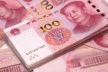 Analysts polled by Reuters had predicted new loans would drop to 800 billion yuan (US$121 billion). October new loans hit the lowest since the same month last year, when the tally was 661.3 billion yuan. Photo: Bloomberg