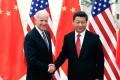 Chinese President Xi Jinping and then US vice-president Joe Biden meet in Beijing in 2013. Photo: TNS