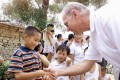 Joe Biden shakes hands with a young Chinese boy in Yanzikou, a village north of Beijing, while chairman of the US Senate foreign relations committee in 2001. Photo: AFP