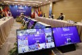 A screen shows Vietnam's Prime Minister Nguyen Xuan Phuc addressing the 37th Asean summit in Hanoi. Photo: EPA