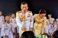 Thailand's King Maha Vajiralongkorn and Queen Suthida greet royalists at an airport in Udon Thani province. Photo: Reuters